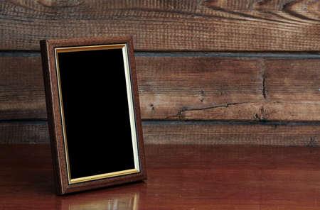 Marco de la foto en la mesa de edad Foto de archivo - 17554162