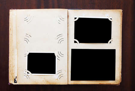 blanked: Vintage photo album with blanked photos on old wooden texture