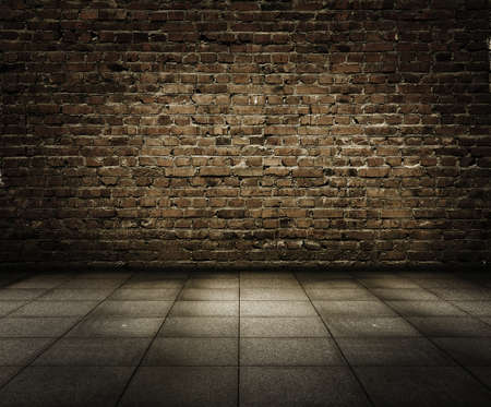cracked wall: old grunge interior with brick wall Stock Photo