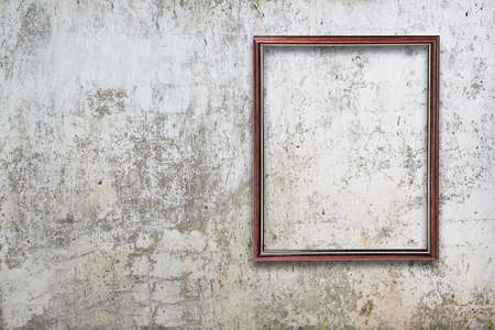 concrete block: blank photo frame on old wall Stock Photo