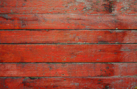wood abandoned: painted old wooden wall. red background  Stock Photo