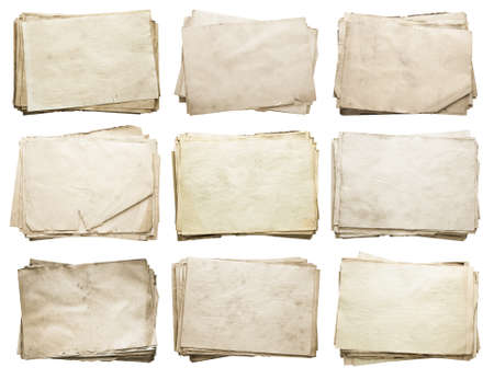 textured paper: stack of old papers set isolated on white background. Stock Photo