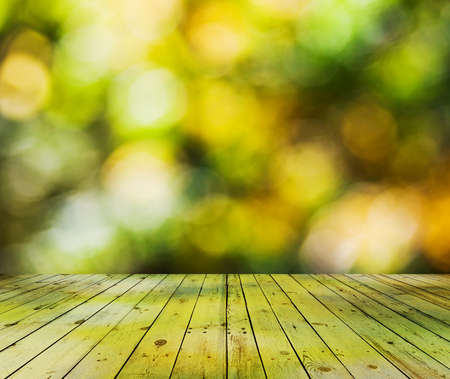 bright background, autumn bokeh and wooden floor photo