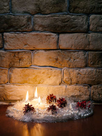 candles against a brick wall photo