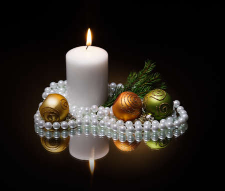 Christmas candle on dark background photo