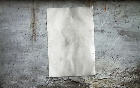 old paper on grey dirty wall  Stock Photo