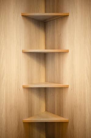 Estantes de madera de la esquina Foto de archivo - 25162788
