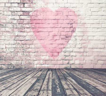 old room with brick wall graffiti heart, valentines day background Archivio Fotografico