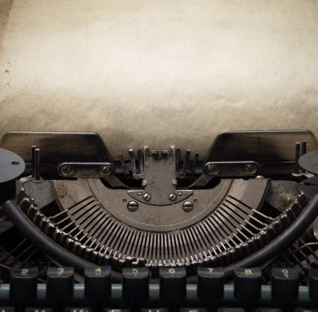 sepia.: old retro typewriter with paper