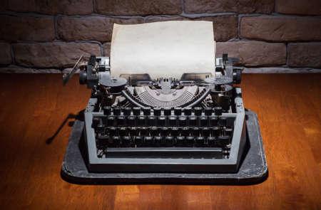 old typewriter on wooden table photo