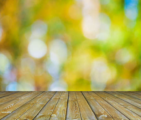 gold colour: bright background, autumn bokeh and wooden floor