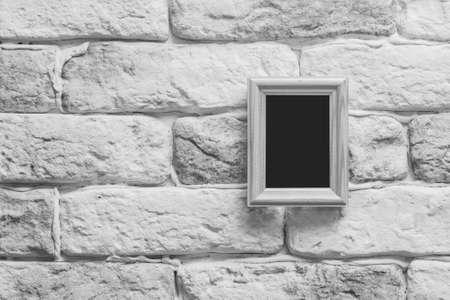 blank photo frame on old gray brick wall photo