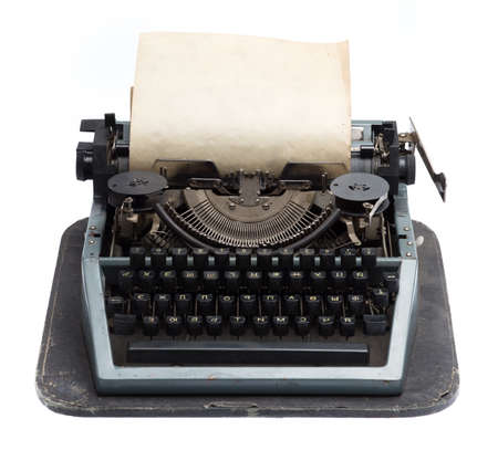vintage typewriter with old paper isolated on white background