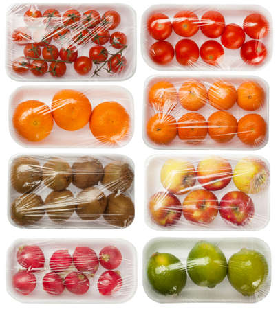 packaging: fruits and vegetables in vacuum packing on white background