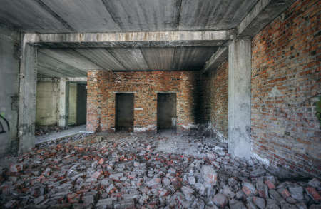 unfinished building: interior of an old abandoned unfinished building Archivio Fotografico