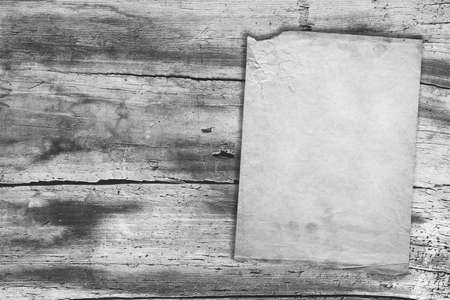 old vintage paper on wood texture, gray background photo