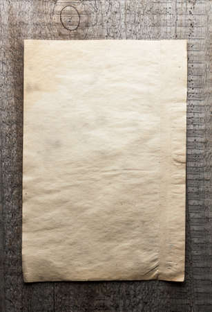 old paper on dirty wooden background photo