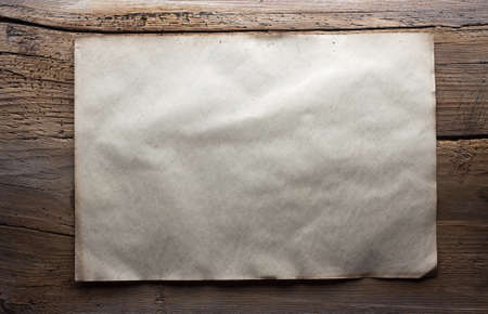 old paper on dirty wooden background Stock Photo