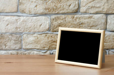 photo backgrounds: old photo frame on the wooden table Stock Photo