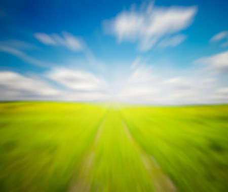 slight: country road in the fields, with slight motion blur Stock Photo