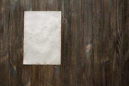 blank note: white paper on old wooden background