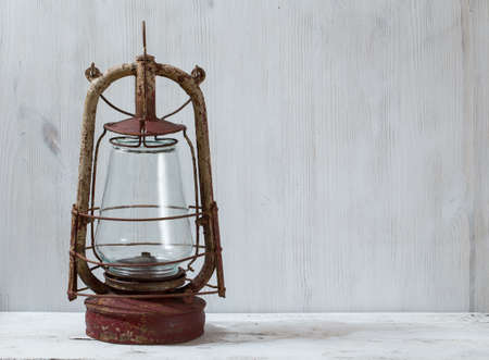 old oil lamp on white wooden table