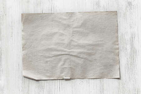 old paper background: old paper on white wooden background Stock Photo