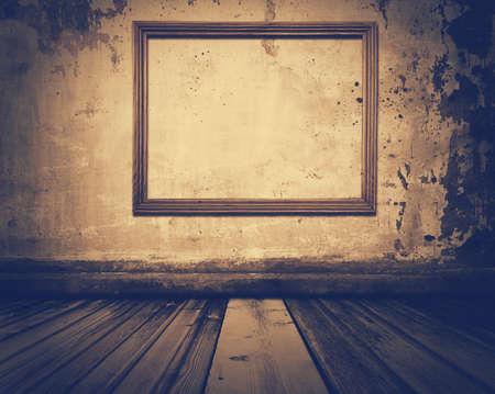 grunge room: old grunge room with pictureframe, retro film filtered