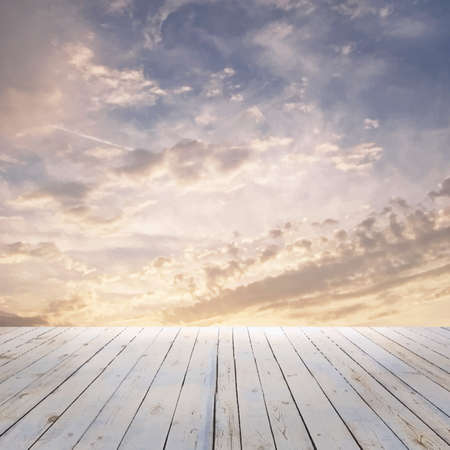 sunset sky: sunset sky and wood floor, background
