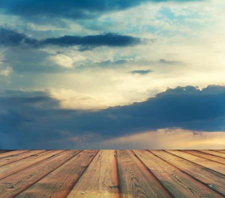 sunset sky: sunset sky and wood floor, filtered background image Illustration