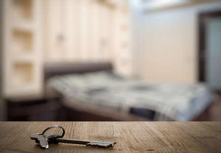 bedchamber: keys on wooden table in the bedroom Stock Photo