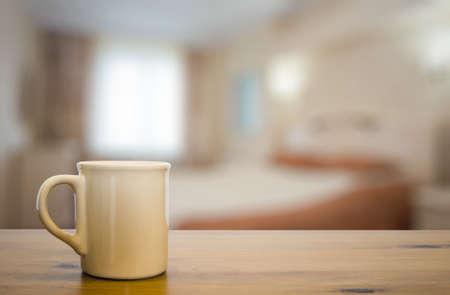 bedchamber: mug on wooden table in the bedroom