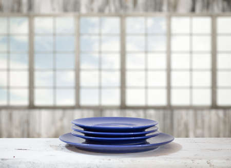big windows: plates on white table in old room with big windows