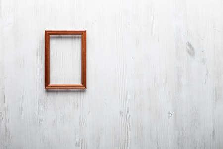 grunge room: photo frame on white wall