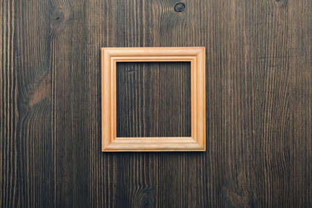 old photo: wooden photo frame on old wooden wall Stock Photo