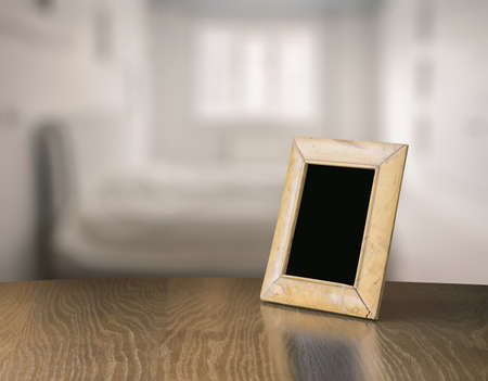 living room design: old photo frame on the wooden table in the bedroom