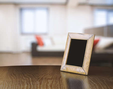 living room design: old photo frame on the wooden table in the living room Stock Photo