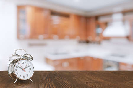 contemporary living room: clock on wooden table in the kitchen