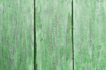 old wooden wall, green background