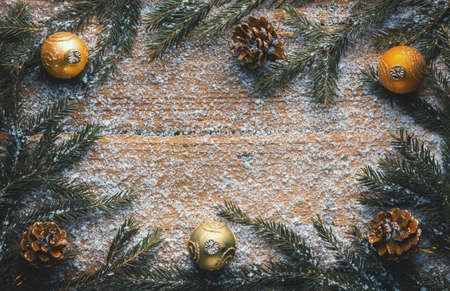 holiday decoration snow, bells, green branch and pine cones on wooden frozen table, christmas background 版權商用圖片