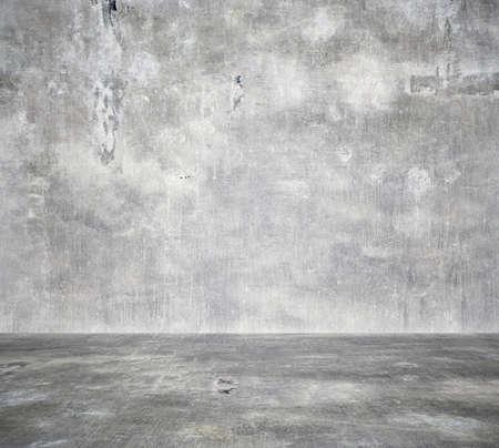 Habitación vacía con muro de hormigón, fondo gris Foto de archivo