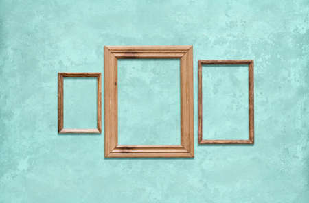 old wooden frames on blue wall Фото со стока - 129819062