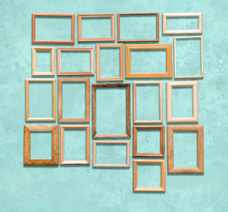 old wooden frames on blue wall Фото со стока - 129819338