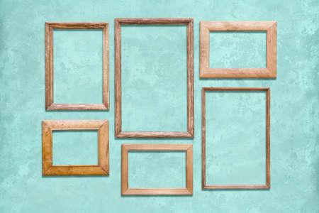 old wooden frames on blue wall Фото со стока - 129819340