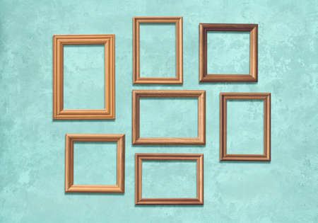 old wooden frames on blue wall Фото со стока - 129819478