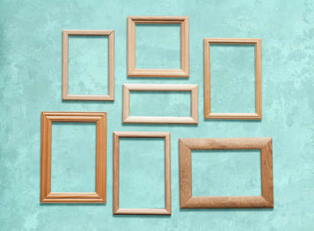 old wooden frames on blue wall Фото со стока - 129819828