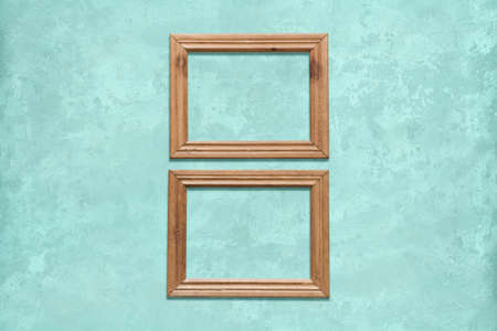 old wooden frames on blue wall Фото со стока - 129819936