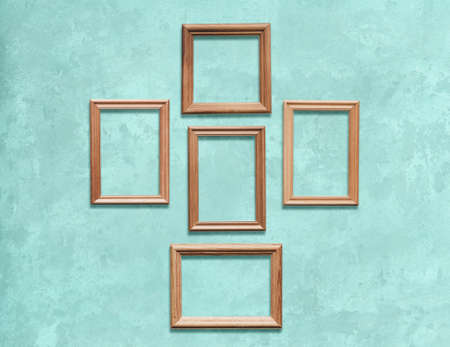 old wooden frames on blue wall Фото со стока - 129820606