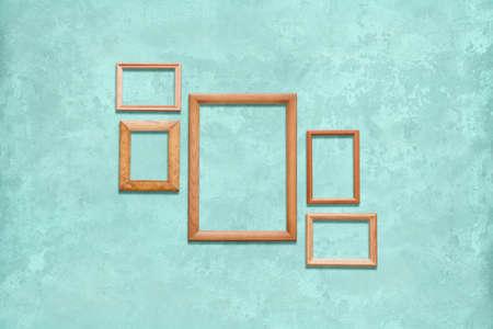 old wooden frames on blue wall Фото со стока - 129821722