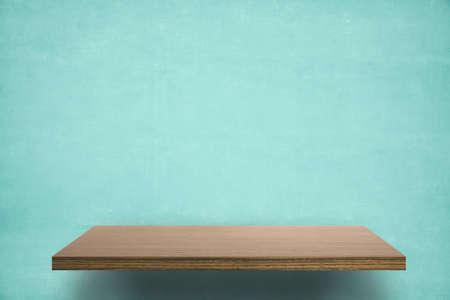 empty shelf on blue wooden wall